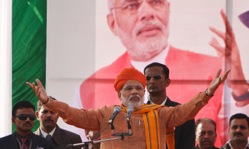 Narendra Modi addresses supporters during a rally in Jammu, India, Sunday, Dec.1, 2013. – AP Photo