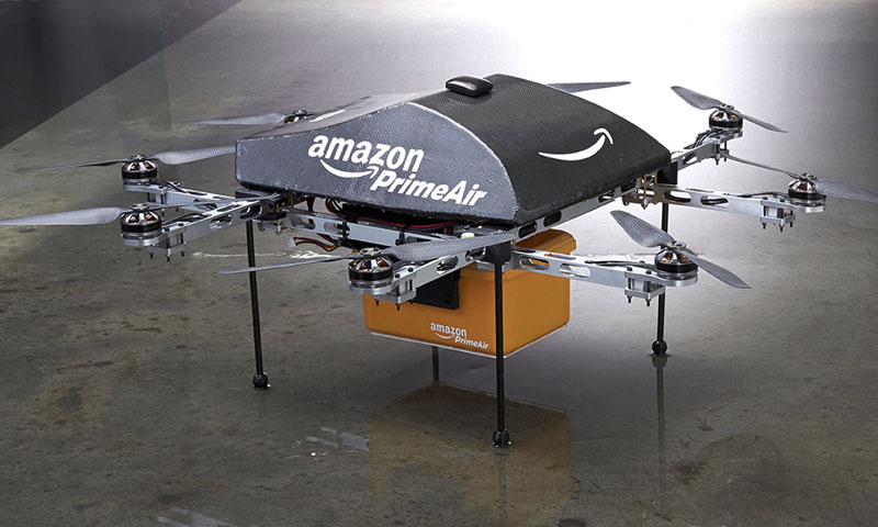 "An Amazon PrimeAir drone is shown in this publicity photo released to Reuters on December 2, 2013. Amazon.com CEO Jeff Bezos told the CBS television program ""60 Minutes"" that the company is testing the use of delivery drones that could deliver packages that weigh up to five pounds, which represents roughly 86 per cent of packages that Amazon delivers, he said.     — Photo by Reuters"