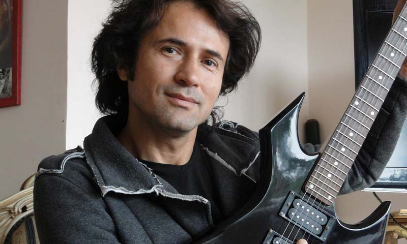 Turkish imam and rock musician Ahmet Muhsin Tuzer poses with his guitar on April 27, 2013 in Kas. — Photo AFP