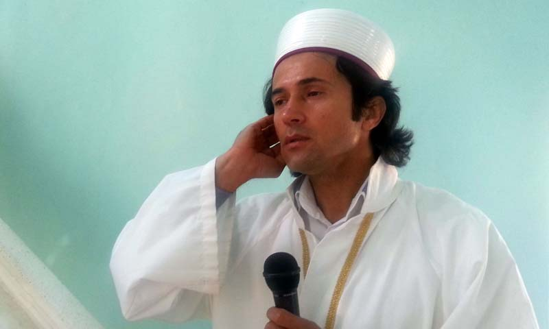 Turkish imam and rock musician Ahmet Muhsin Tuzer gives the call to prayer on February 11, 2013, in Kas. — Photo AFP