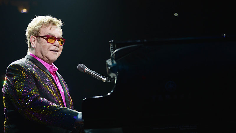 Musician Elton John performs his commemorative 64th show at Madison Square Garden on December 4, 2013 in New York City.   - Photo by AFP