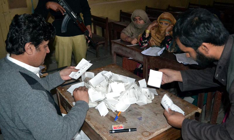 Polling officials count the vote after polling of Local Bodies Elections in Balochistan. — Photo by INP