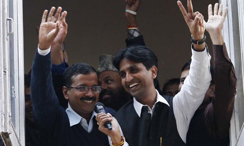 Arvind Kejriwal (L), leader of the newly formed Aam Aadmi (Common Man) Party, waves to his supporters after his election win against Delhi's Chief Minister Sheila Dikshit, at his party office in New Delhi December 8, 2013. — Photo Reuters
