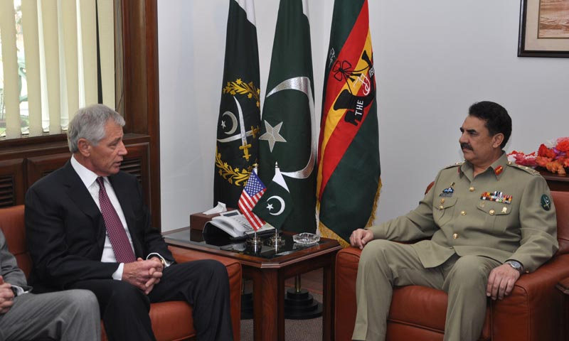 In this handout photograph released by Pakistan's Inter Services Public Relations (ISPR) on December 9, 2013 Pakistan's army chief General Raheel Sharif (R) meets with US defence secretary Chuck Hagel at the General Headquarters in Rawalpindi. — Photo by AFP
