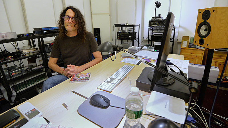 "David Chesky, a composer with his own record label, sits in his studio on December 10, 2013 in New York. Chesky runs a music download site called HD Tracks, offering ""high resolution"" music which keeps much of the fidelity lost in most digital music. – Photo by AFP"