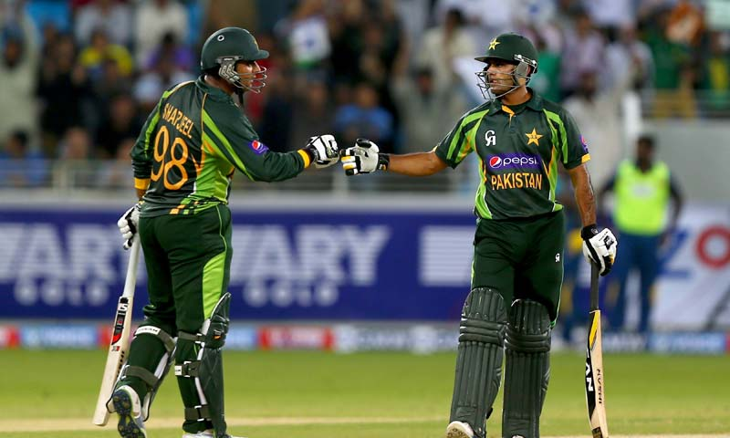 Mohammad Hafeez (r) (32) and Sharjeel Khan (l) (34) steadied the innings through their 57-run second wicket stand. -Photo by AFP