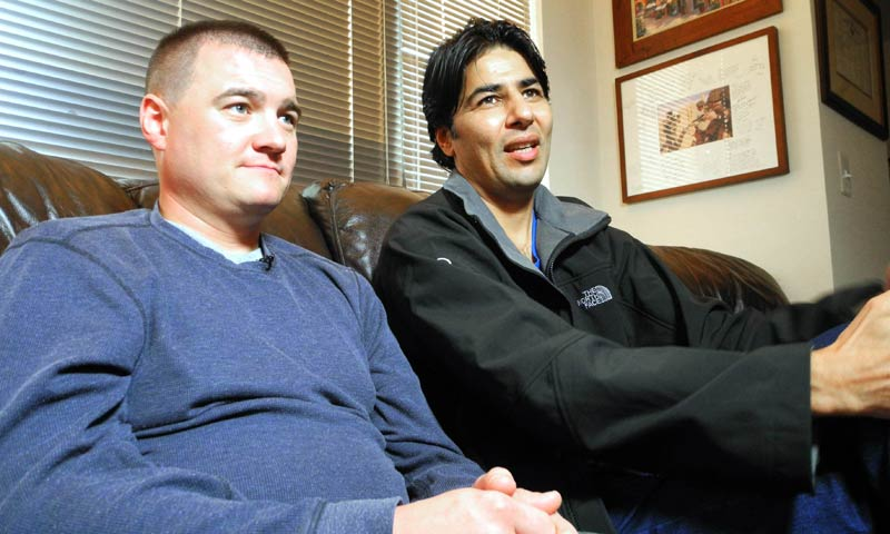 US Army Captain Matt Zeller (L) with translator Mohammad Janis Shinwari, whom he credits for saving his life in a firefight in Afghanistan in Nov 2008, is pictured during an interview on Nov 21, 2013 in Arlington, Virginia. After five years of struggle, Shinwari is one of the lucky few who was able to take advantage of the special visa program for Afghanistan interpreters. — Photo by AFP
