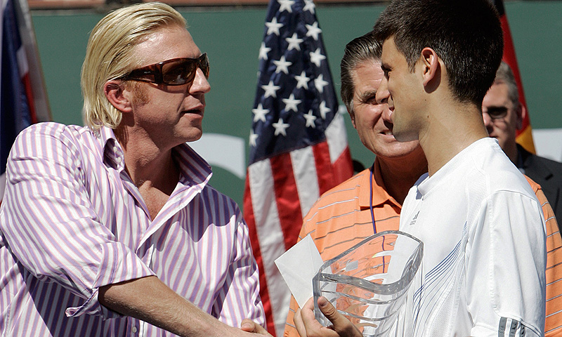 Picture taken on March 18, 2007 shows Novak Djokovic (R) of Serbia recieving the second place trophy from former tennis player Boris Becker of Germany at the 2007 Pacific Life Open tennis tournament in Indian Wells. -Photo by AFP