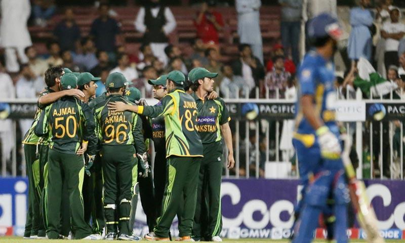 Pakistani players celebrate after Kumar Sangakkara of Sri Lanka was caught out  during the 1st One Day International between Sri Lanka and Pakistan in Sharjah. -AFP Photo