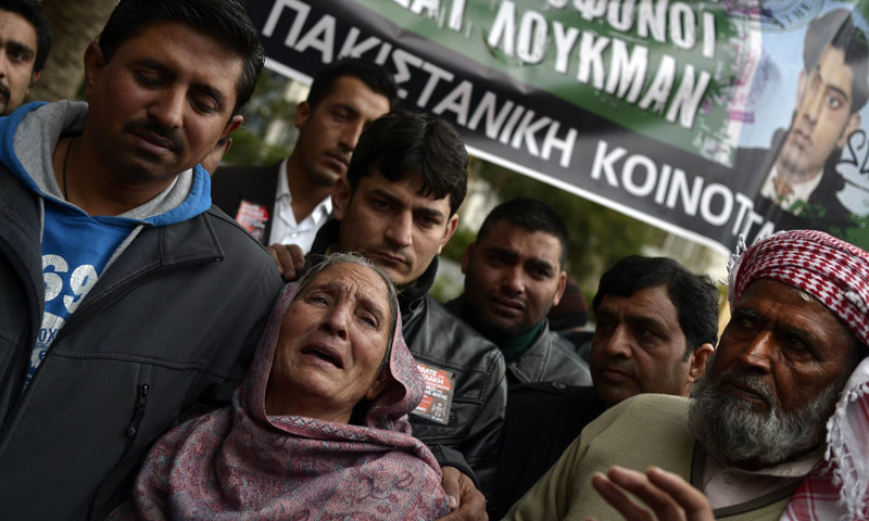 The mother of Shehzad Luqman reacts as she leaves an Athens court where two suspected members of the Greek neo-Nazi party Golden Dawn accused of her son's murder are being judged on December 18, 2013. – AFP