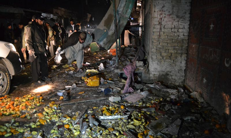 Pakistani investigators look for evidence at the spot of a blast in Quetta. -AP Photo