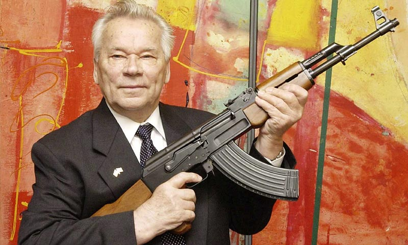 """In this July 26, 2002 file photo, Russian weapon designer Mikhail Kalashnikov presents his legendary assault rifle to the media while opening the exhibition """"Kalashnikov - legend and curse of a weapon"""" at a weapons museum in Suhl, Germany. -AP Photo"""