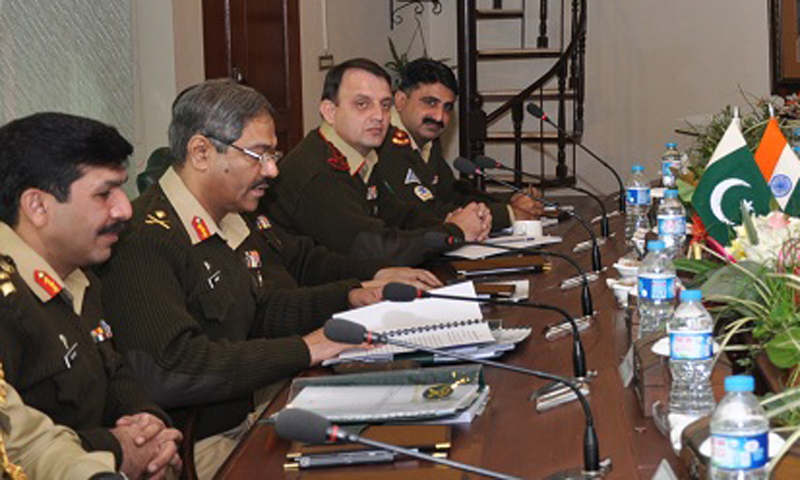 A view of meeting between Maj Gen Aamer Riaz, Pakistan Army DGMO and Lt Gen Vinodh Bhatia,Indian Army DGMO . Meeting was held towards Pakistan side at Wagh border at Lahore on Tuesday 24 December 2013. — Photo courtesy of ISPR