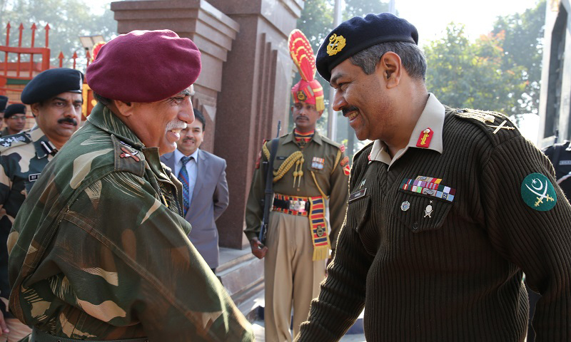 Maj Gen Aamer Riaz, DGMO Pakistan Army receiving his counter part, DGMO Indian Army Lt Gen Vinodh Bhatia on arrival at Wagha Border on tuesday 24 December 2013. — Photo courtesy of ISPR