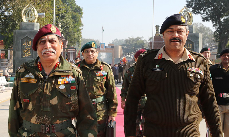 Maj Gen Aamer Riaz, DGMO Pakistan Army with his indian counter part Lt Gen Vinodh Bhatia after later's arrival at Wagha Border on Tuesday 24 December 2013. —   Photo courtesy of ISPR