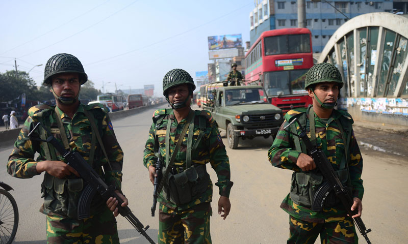 Tens of thousands of troops were to be deployed across Bangladesh Thursday in a bid to contain deadly political violence ahead of elections which are being boycotted by the opposition. — Photo by AFP