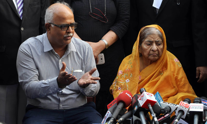 Zakia Jafri listens to her son Tanveer Jafri, son of former Congress lawmaker Ehsan Jafri, after a court ruling rejecting a petition seeking the prosecution of Bharatiya Janata Party leader Narendra Modi in Ahmadabad, India. — Photo by AP