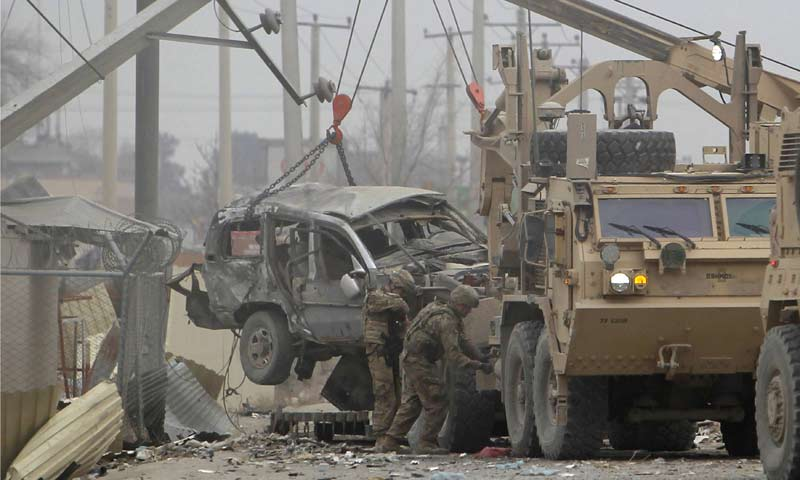 US trucks lift up an armoured vehicle hit by a bomb attack in Kabul. -Reuters Photo