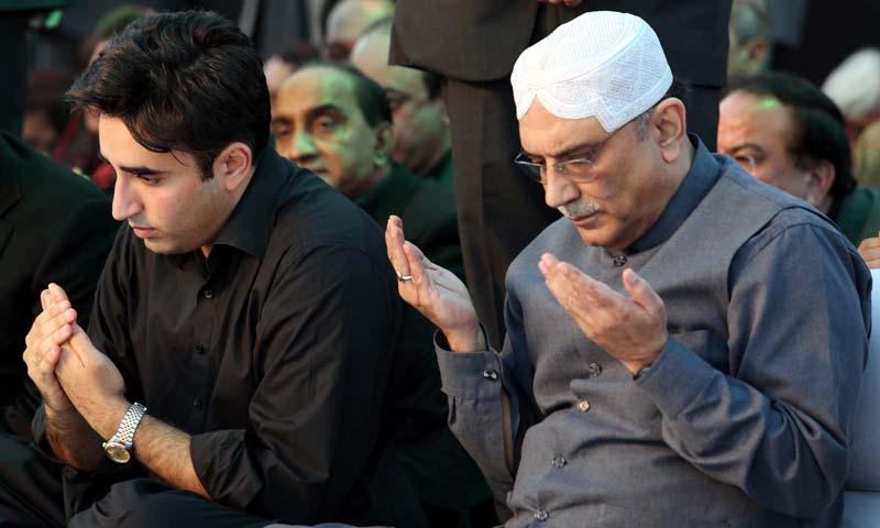 Former president Asif Ali Zardari and PPP patron-in-chief Bilawal Bhutto Zardari offer Fateha during public gathering in Garhi Khuda Bakhsh on Friday, December 27, 2013. – PPI Photo