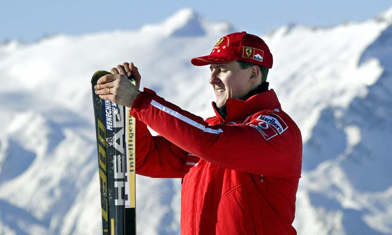 Picture taken on January 17, 2003 shows Formula one World champion Ferrari driver Michael Schumacher holding his skis before a giant slalom race in Madonna di Campiglio. — Photo AFP