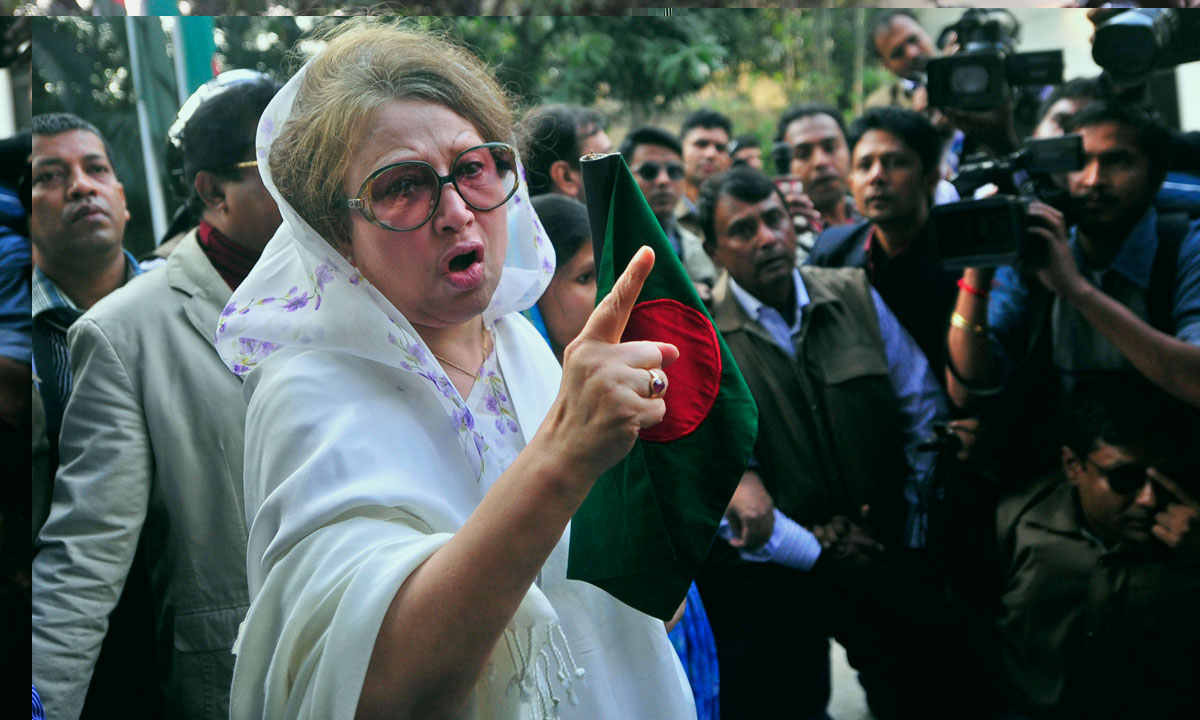 Bangladesh's former Prime Minister and main opposition Bangladesh Nationalist Party (BNP) leader Khaleda Zia gestures as she walks out of her home in Dhaka, Bangladesh, Sunday, December 29. – Photo by AP
