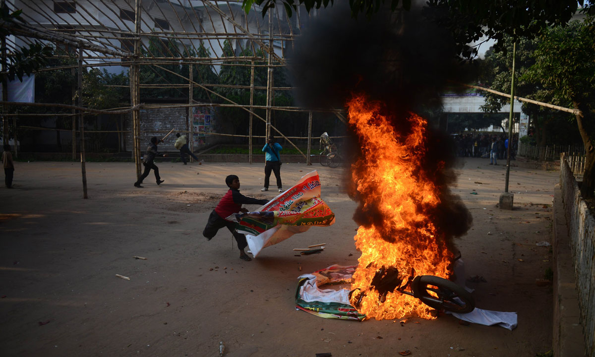 A Bangladeshi youth sets fire to a motorbike during a protest by the Bangladesh Nationalist Party (BNP) in Dhaka on December 29. – Photo by AFP
