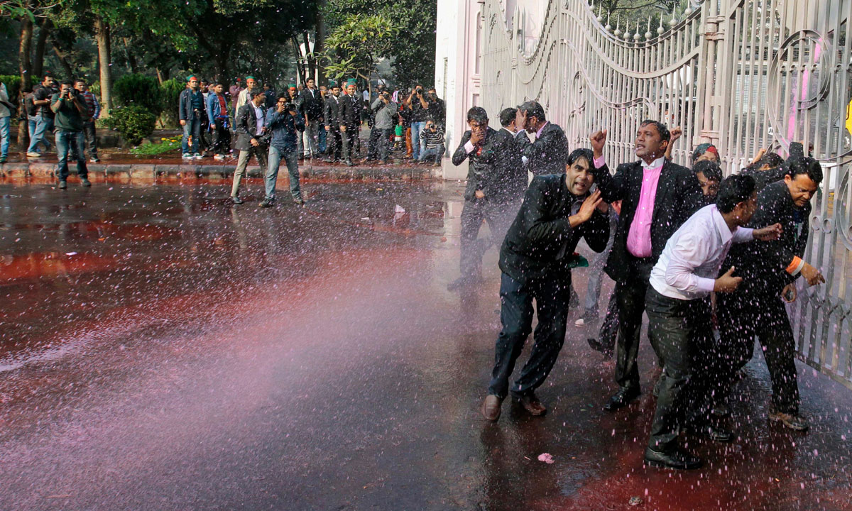 Opposition Bangladesh Nationalist Party (BNP) lawyers are hosed with water cannons by police during a protest in Dhaka, Bangladesh, Sunday, December 29. – Photo by AP