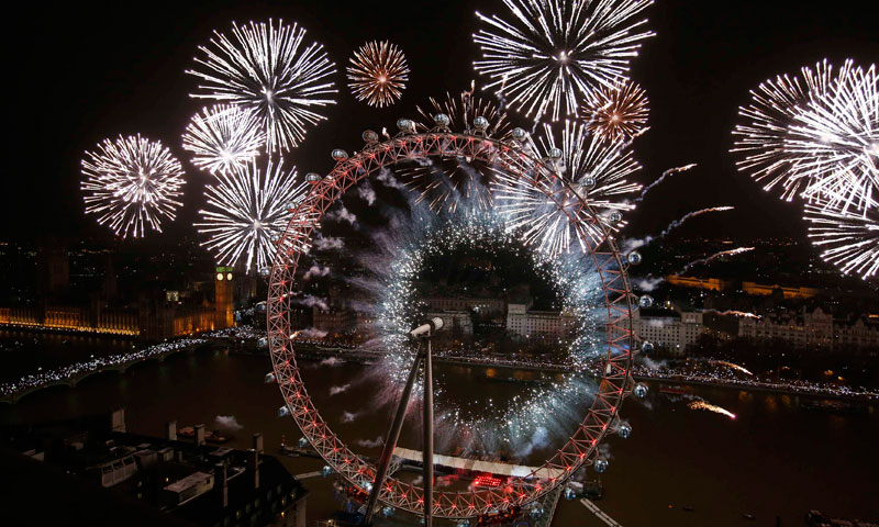 Fireworks explode across a London skyline near the London Eye during New Year celebrations in London. — Photo by Reuters