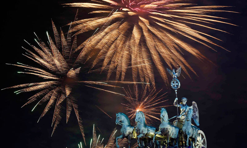 Fireworks explode next to the Quadriga sculpture atop the Brandenburg gate during New Year celebrations in Berlin January 1, 2014.— Photo by Reuters.