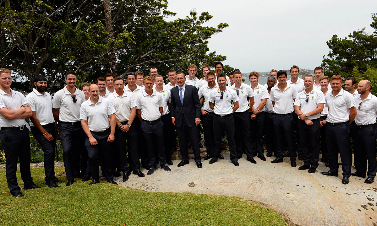 Australia's Prime Minister Tony Abbott (C) pose for a group photograph with England and Australian cricketers at a New Year's Day reception at Kirribilli House in Sydney on January 1, 2014. The arch arrivals Australia and England will face each other in the fifth Ashes Test in Sydney starting from January 3. – Photo by AFP
