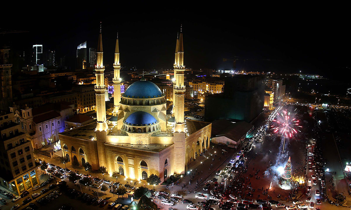 Fireworks light up the sky in down town Beirut close to the Mohammed al-Amin mosque as Lebanon rings in the New Year on January 1, 2014. – Photo by AFP