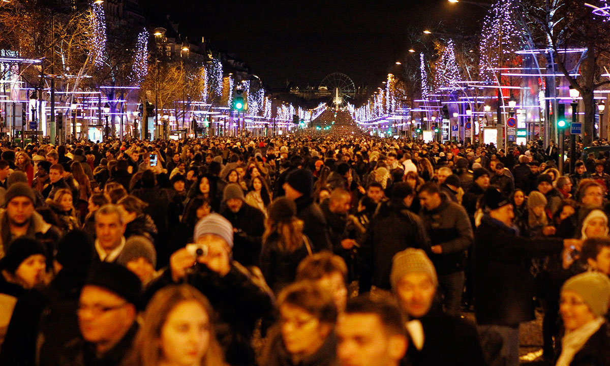 Revellers celebrate the New Year's Eve on the Champs Elysees avenue in Paris, France, Wednesday Jan. 1, 2014. – Photo by AP