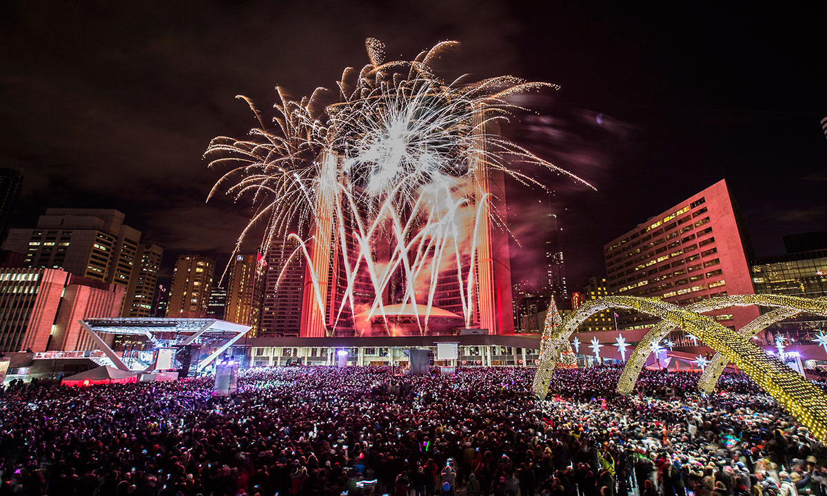 Fireworks explode during Year's Eve celebrations at Nathan Phillips Square in Toronto,  Wednesday, Jan. 1, 2014. – Photo by AP