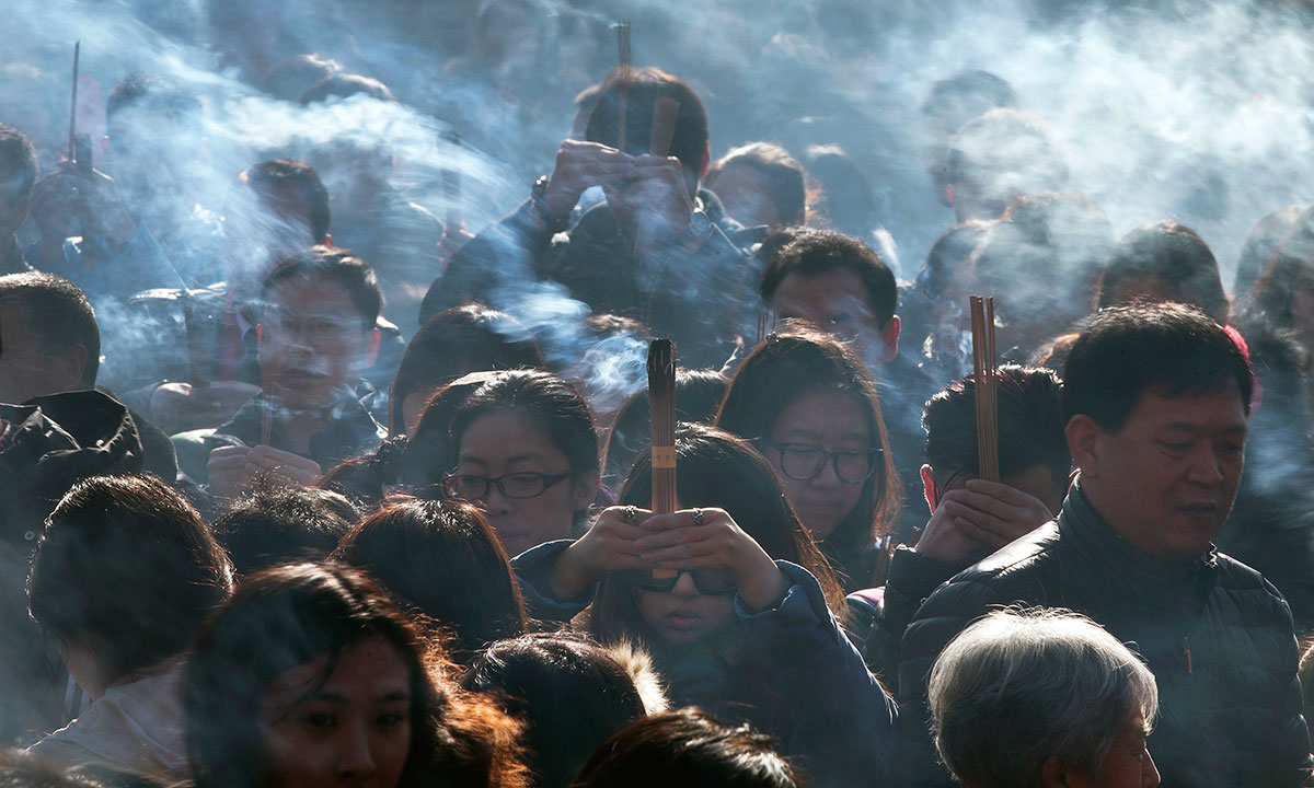 Chinese worshippers burn incense while offering prayers on the first day of the New Year at the Yonghegong Lama Temple in Beijing Wednesday, Jan. 1, 2014.  – Photo by AP