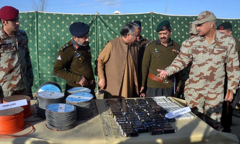 Inspector General Frontier Corps Balochistan Major General Muhammad Ejaz Shahid (R) inspecting explosives and weapons seized by FC near Chaman on Friday. – INP Photo