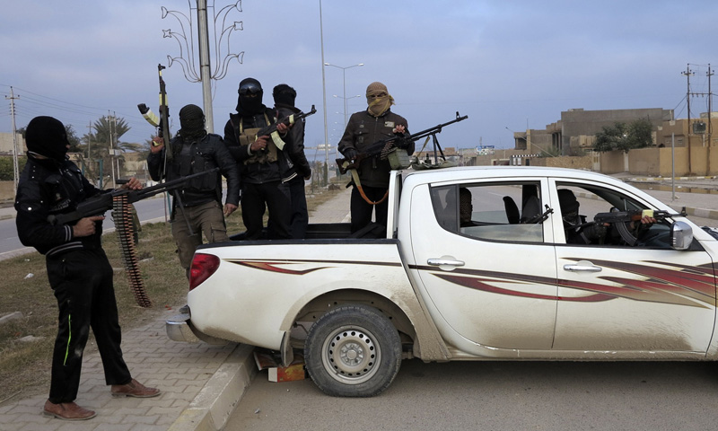 Armed tribesmen deployed on the streets take control of the city of Ramadi January 4, 2014. – Reuters Photo