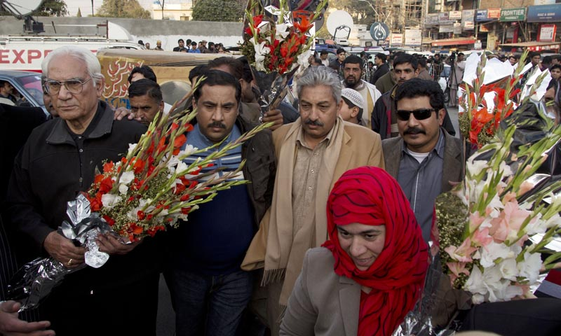 Ahmed Raza Kasuri, one of the lawyers of Pakistan's former military ruler Pervez Musharraf, arrives to place a bouquet outside the Armed Forces Institute of Cardiology in Rawalpindi on January 3, 2014, where Musharraf is being treated. — Photo by AP