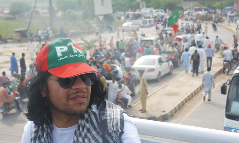 Taking it all in: DJ Butt enroute PTI's Minar-i-Pakistan rally on March 23, 2013.
