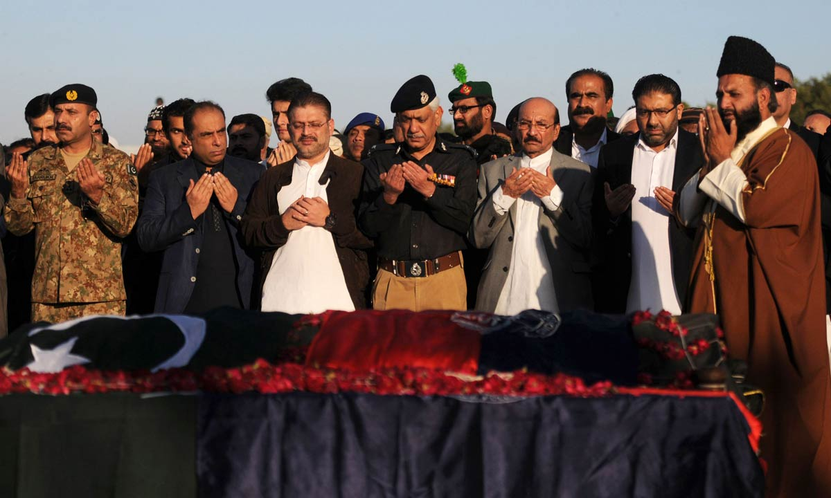 Government and security officials offer the funeral prayer for Chaudhry Aslam and his two slain colleagues in Karachi, Jan 10, 2014. — AFP