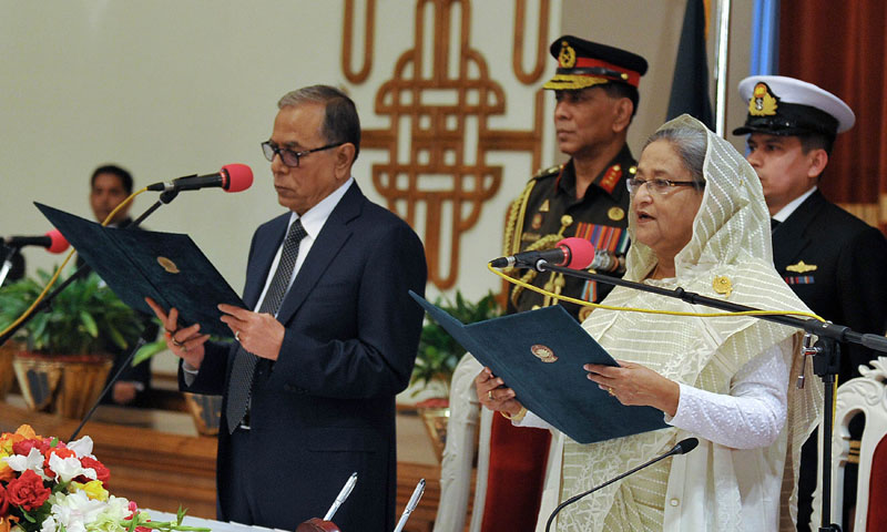 Bangladesh President Abdul Hamid (L) swears in Sheikh Hasina Wajed (R) for her third term as Bangladesh's prime minister at the Presidential Palace in Dhaka on January 12, 2014. — Photo by AFP