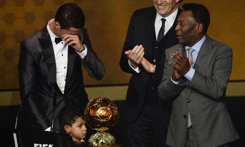 Cristiano Ronaldo of Portugal, left, cries as he is awarded the prize for the FIFA Men's soccer player of the year 2013 at the FIFA Ballon d'Or 2013 gala at the Kongresshaus in Zurich, Switzerland. -AP Photo