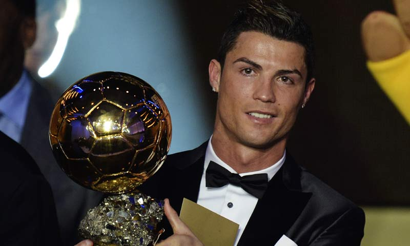 Cristiano Ronaldo of Portugal is awarded the prize for the FIFA Men's soccer player of the year 2013 at the FIFA Ballon d'Or 2013 gala at the Kongresshaus in Zurich, Switzerland. -AP Photo