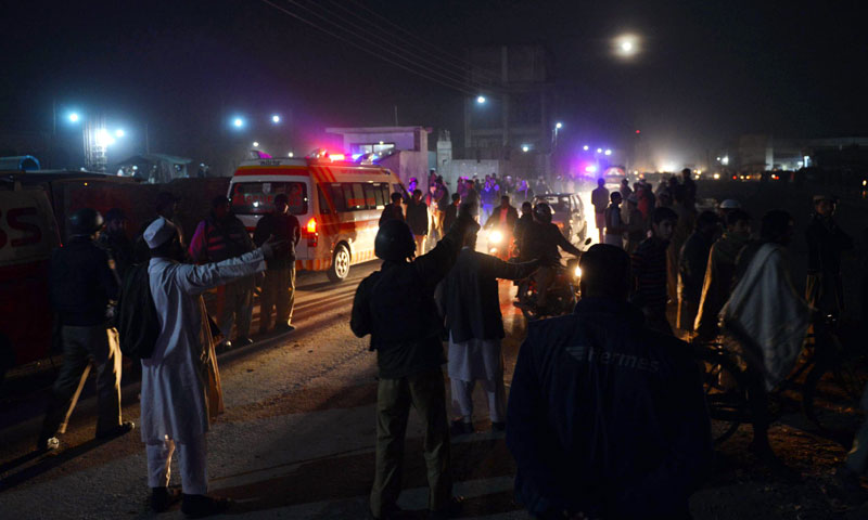 People gather outside the Tableeghi Markaz after a bomb explosion in Peshawar on January 16, 2014. —AFP Photo
