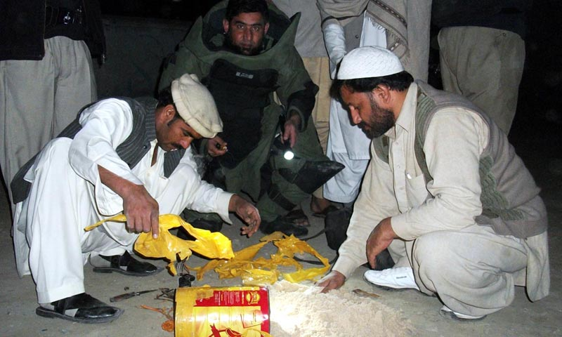 Experts of bomb disposal squad defuse a bomb which was found from a central seminary in Nowshera on Thursday. – Photo by Online