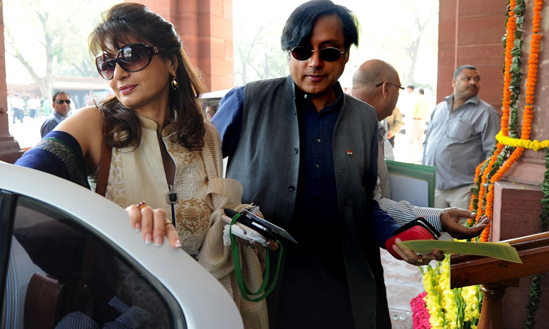 In this photograph taken on March 12, 2012 ex-junior minister for external affairs and Congress Party's Member of Parliament Shashi Tharoor (R) with his wife Sunanda Pushkar arrive at parliament. -Photo by AFP