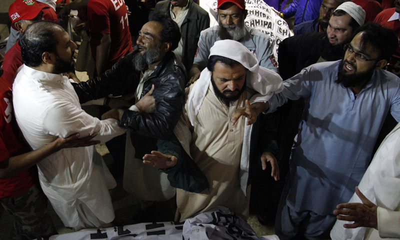 Family members of religious clerics mourn at a local hospital in Karachi, Pakistan, Friday, Jan. 17, 2014. — Photo by AP
