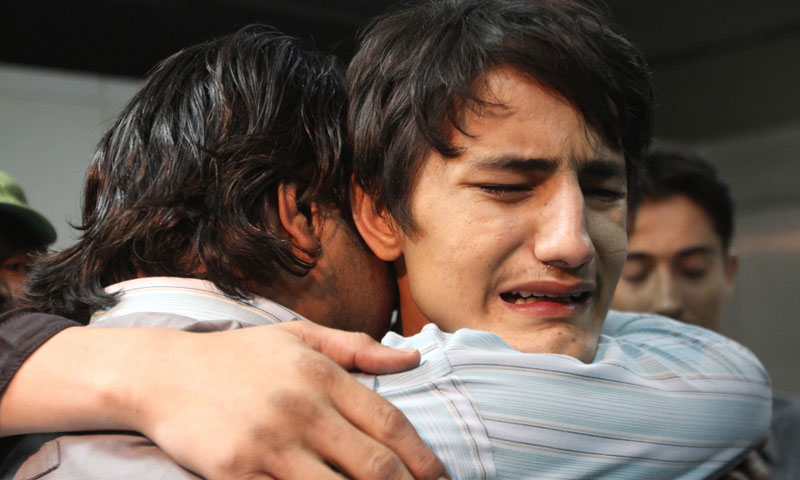 Family members mourn the deaths of local news channel employees at a hospital in Karachi, Pakistan, Friday, Jan. 17, 2014. — Photo by AP