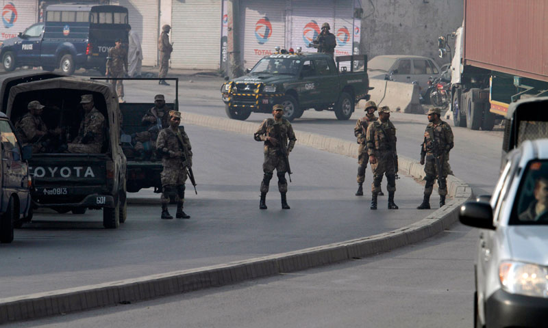 Army troops secure a road leading to the site of a suicide bombing in Rawalpindi, Pakistan, Monday, Jan. 20, 2014. — Photo by AP