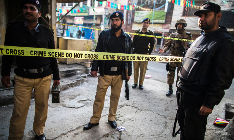 Security officials cordon off the site of a suicide blast in Rawalpini January 20, 2014. — Photo by Reuters