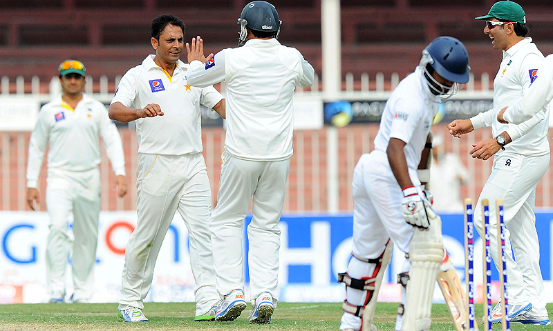Abdur Rehman celebrates one of his four wickets. -Photo by AFP